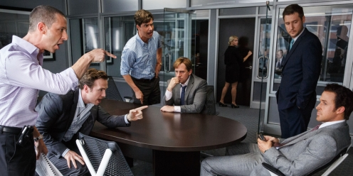 "This photo provided by Paramount Pictures shows, Jeremy Strong, from left, as Vinny Peters, Rafe Spall as Danny Moses, Hamish Linklater as Porter Collins, Steve Carell as Mark Baum, Jeffry Griffin as Chris and Ryan Gosling as Jared Vennett, in the film, ""The Big Short,"" from Paramount Pictures and Regency Enterprises. (Jaap Buitendijk/Paramount Pictures via AP)"